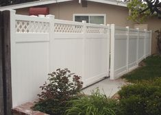 vinyl lattice topped privacy fence with driveway gate