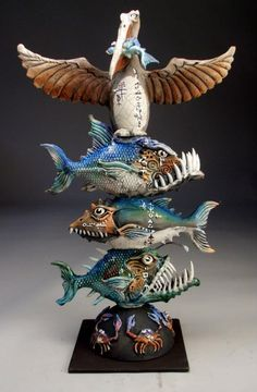 Grafton Pottery Monster Fish Totem Pole - a metal rod welded to the metal base holds everything together. Description from pinterest.com. I searched for this on bing.com/images