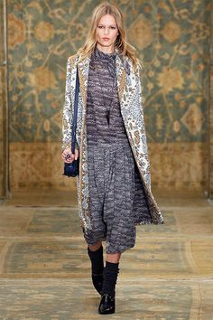 Masculine-feminine: a menswear-cut statement coat over a pleated silk dress #toryburch #toryburchfall15  #nyfw