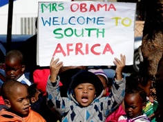 Children sing as U.S. first lady Michelle Obama, unseen, visits the Hector Pieterson Memorial in Soweto, South Africa Wednesday June 22, 2011. (AP Photo/Themba Hadebe)