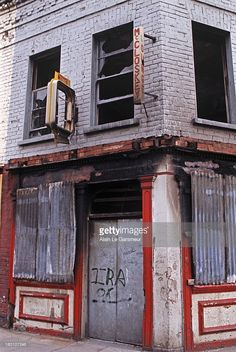 MAY 1972. IRA graffiti on fire-bombed damaged shop during The Troubles, Northern Ireland.