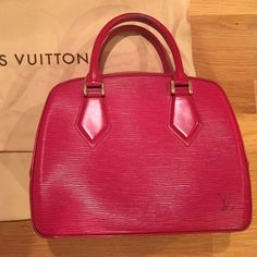 Louis Vuitton Red Epi purse (no trades) Guaranteed authentic. LV red Epi purse. Wear on the handles as shown in pic. Minor scuffs on bottom. Some wear near zipper. Inside is completely clean. Comes with dustbag. Sold as is. All sales are final. Louis Vuitton Bags