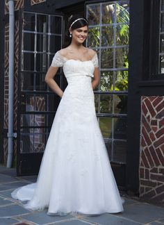 Sincerity wedding dress style 3734 A strapless tulle A-line gown with beaded lace, a satin bias back, and a  bow at the empire waistline. Buttons cover back zipper and this style  has a chapel length train and a detachable caplet.
