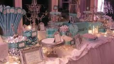 Tiffany blue candy buffet.. candy is ordinary here but the silver frames and candles add the wow factor. EM
