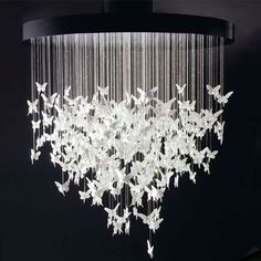 White light fixture with hanging (flying) butterflies.