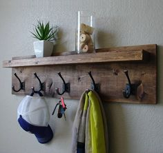 Modern meets rustic in this handmade coat rack with dark bronze hooks. Perfect for any home, condo, or country cottage. Made from solid wood. It has