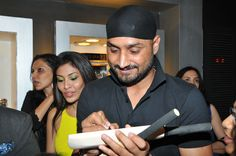 Harbhajan Singh gives an autograph to a guest at Rose - The Watch Bar