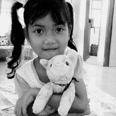 Kid and cat doll