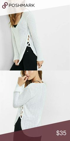 Express Lace-Up Side V-Neck Pullover Sweater The deep V-neck and feminine lace-up side lend endless bohemian chic to this shaker knit sweater. Pair this with your favorite denims for a killer look that can't be beat. Only wore this sweater once and it's too small on me, too bad because I love it! Express Sweaters V-Necks