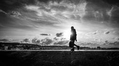 A man at sunset - Howth Ireland - Black and white street photography by pixael Street Photography, Ireland, Sunset, Black And White, Gallery, Pictures, Design, Photos, Black N White