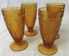 Set of Four Amber Glass Footed Drinking Glasses, Vintage Drinkware, Kitchen, Harvest Gold Barware, Footed Glass Tumbler by GinnysGirlsTreasures on Etsy Drinkware, Barware, Triangular Pattern, Tea Glasses, Gold Kitchen, Gold Set, Amber Glass, Vintage Items, Candle Holders