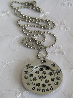 """BDSM Owned  submissive discreet day collar/necklace.Aluminium pendant stainless steel chain.Handstamped """"Owned"""" flowers and dragonflies. by DarkAngelDesires on Etsy"""