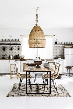 Read on to see how to create a contemporary ethnic look at home with unique global elements, without straying from a black and white colour palette.
