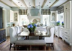 eat in kitchen with table pulled to the island--love the bench at the end too!