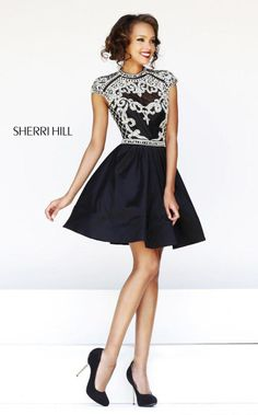 The details are everything in the cute cocktail from Sherri Hill. It has rhinestones, pearls and studs in its exquisite bodice and a fun full skirt. View Size Chart