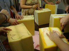 we draw out the puppets on the foam blocks before carving them