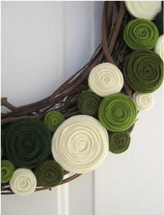 felt 'flowers' on natural wreath...SO EASY!  I need these on my front door.