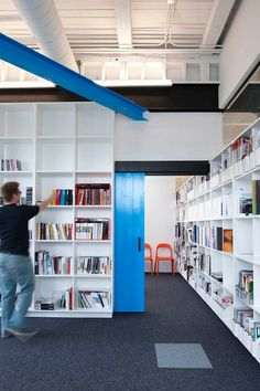 Mono Office Library - I love the accent colours and bookcases.