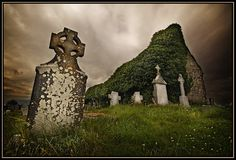 Gravestones and ruins in an old cemetry near a small village south of Galway ( Ireland). By Dave Basset