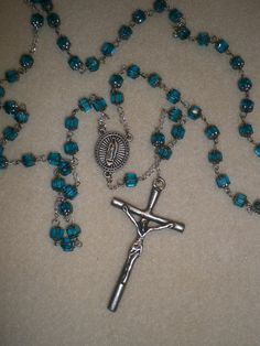 Rosary used for a Series of Prayers & Reflecting Meditations on the Incarnation, Life, Trials, Death, Resurrection  and Ascension into Heaven of Jesus the Christ - mini-Gospel - Aqua Glass Bead Rosary Beads with Silver Pewter Cross.. $30.00, via Etsy.