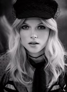 Ready for her closeup, Gabriella Wilde wears Dior hat, necklace, top and bralette