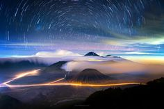 Photograph Startrails Bromo by Anuchit (star trail. (astronomy, photography) The line of light recorded on a photographic medium when a time exposure is made of a star in the nighttime sky using a camera on a fixed mount, caused by the rotation of the earth during the period of time when the camera's shutter is held open.)