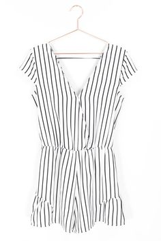 Simplistic vertical striped romper with short cap sleeves, a flattering V neckline and back. Hidden snap button closure on neckline to wear open or closed. Non-