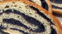Homemade poppy seed filling is rolled up inside a buttery yeast dough and baked until golden brown. The recipe yields 2 filled loaves.