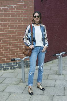 A silk bomber jacket, straight jeans, and oxfords.