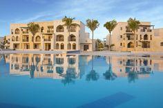Resort swimming pool overlooking villas @salalahrotana  #SRRPinToWin