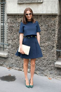 Shop this look on Lookastic:  http://lookastic.com/women/looks/cropped-top-pumps-sunglasses-full-skirt-clutch/2320  — Navy Cropped Top  — Green Suede Pumps  — Grey Sunglasses  — Navy Full Skirt  — Beige Leather Clutch