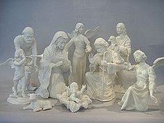 """This Boehm nativity set is composed of porcelain with a white matte glaze. This monochromatic theme allows a regal focus upon the detail, expressions and, individuality of each piece. The set consists of six pieces in total: two shepherds, a lamb, Joseph, Mary and baby Jesus. Each piece is marked on the underside, """"Boehm, Christian Era Collection, Spirit of Bethlehem, Made in the U.S.A."""" The underside also displays a picture of a crucifix, a horse head and, a feather."""