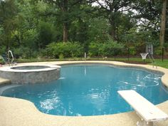 beautiful Free Form Pool design and diving board #freeform #swimmingpool #pools #BarringtonPools