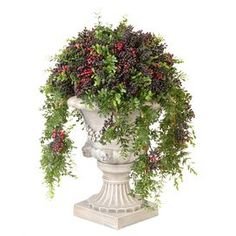 """Bring an organic touch to your home decor with this lovely topiary, showcasing a faux pepper berry ball in an eye-catching urn.  Product: TopiaryConstruction Material: Polyethylene and resinColor: Grey, black and beigeFeatures:  Includes faux boxwoodSuitable for indoor and outdoor useWeather, water, fade and scratch resistant finish Dimensions: 21"""" H x 14"""" Diameter"""