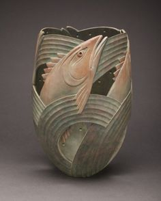 """CONFLUENCE Ron Layport 2015 Size H: 13 in W: 9 in D: 9 in Available for Purchase - at the 2015 AAW Symposium Turned, carved, pigmented Sycamore vessel made for the AAW """"Merging"""" exhibition at the Symposium in Pittsburgh. Exhibition theme is based on two rivers merging in Pittsburgh to form the Ohio."""