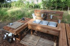 This is an example of a yet-to-be-used mud kitchen. There is ample space in and around the centre for children to play. Multiple bins for mixing water and mud, and easy access to different tools (containers, pots, spoons, etc...).