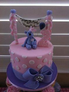 Pink and purple teddy bear cake