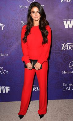 Chic Style: Selena Gomez in Valentino red jumpsuit + black clutch and pointy shoes at Variety and Women in Film Annual Pre Emmy Celebration. #BestDressed