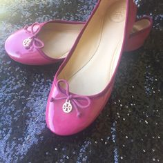 Tory Burch Ballet Flats Raspberry colored patent leather flats accented with bow and gold charm. They are light, comfortable, and easy to wear. Gently used, but still a lot of life in them! Tory Burch Shoes Flats & Loafers