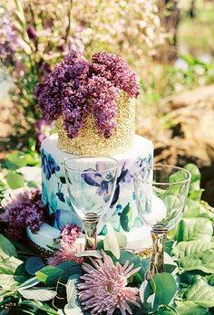 Brides: Two-tiered floral cake with gold top tier. A two-tiered floral wedding cake with a gold top tier created by Mishelle Handy Cakes.