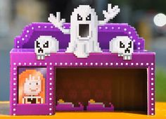 PixelMogul - Ghost Train and Limo Lotti Kiosk Paper Models - via Paper Replika - These Ghost Train and Limo Lotti Kiosk paper models in Pixel style are based on a game called PixelMogul, for iPhone and iPad and they were originally posted at Paper Replika website. Take a visit there to download them.