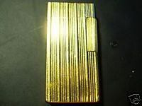RDM - Rolex Dunhill Montblanc Luxury Collectors & Connoisseurs International Club  Per info e acquisti: Danilo Arlenghi  335 6815268 daniloarlenghi@partyround.it  Photo 3 : Dunhill 70 gold plated vertical lines