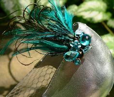 Aquamarine, Aqua, Teal, jeweled shoe clips with Peacock, furl, and matching feathers set of 2. $19,95, via Etsy.