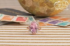 Be the center of attention during your travels while you wear this unique Kunzite with Sapphire and Diamond accents! [Promotional Pin]