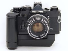 One of my first professional cameras.  BLACK OLYMPUS OM-2N