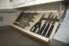 The DropBlock. Store your knifes under the upper cabinets, off the counter tops. Cleaver