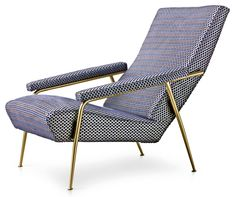 Limited edition Armchair designed by Gio Ponti in 1953 upholstered with Rubelli fabric. Courtesy of Molteni.