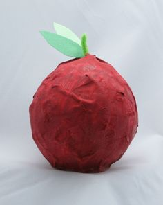 This art activity encourages your child to create her own papier-mache apple sculpture to give to a special teacher.