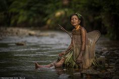 Short rest: A Mentawai woman takes a cigarette break during a fishing expedition to the local river