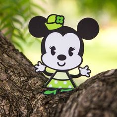 Add a little luck to your day by placing St. Patrick's Day Minnie on your shelf.